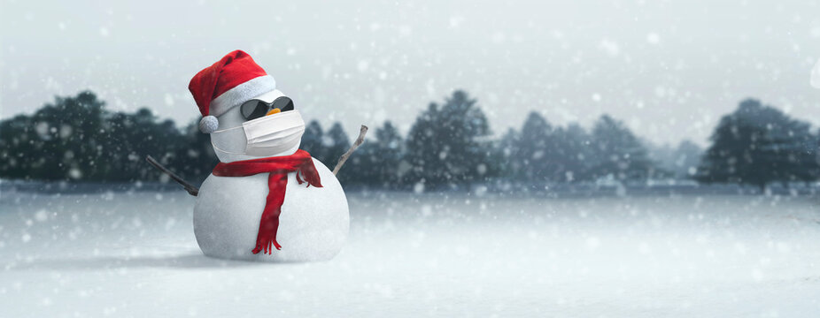 Concept: snowman sunglasses, Santa hat and mask during coronavirus pandemic on sunny Christmas afternoon COVID-19