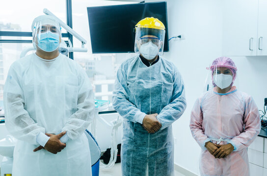 A group of doctors in protective suit against the virus