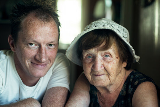Portrait of man with his old grandmother.