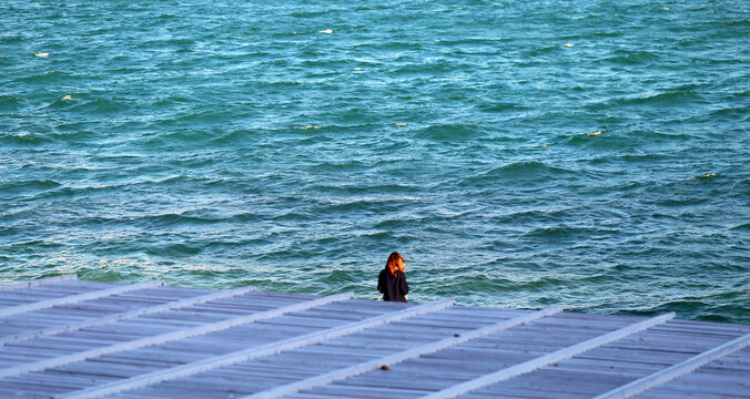 Photo of the endless blue sea with a pier