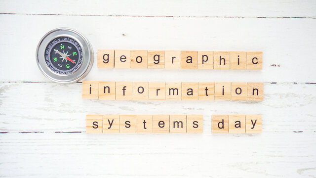 Geographic Information Systems Day.words from wooden cubes with letters photo