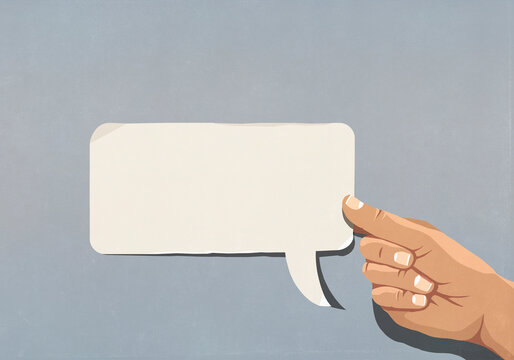 Hand holding blank speech bubble