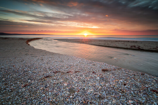 Amazing sunrise view with colorful sky at the sea coast