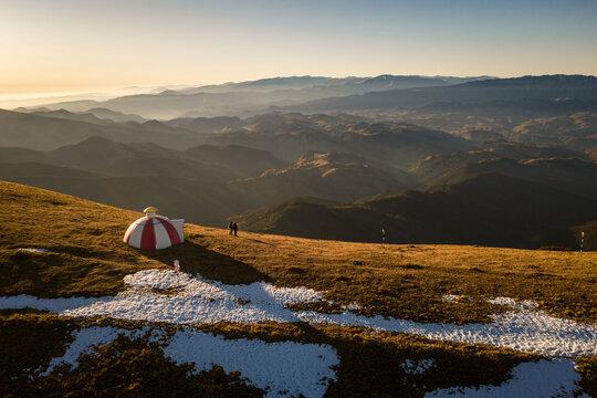 Drone photograph of Batrana mountain refuge high at 2170m in Bucegi Mountains, Romania, on a beautiful autumn day