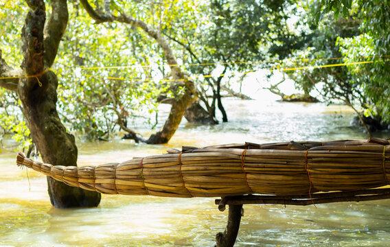 Old traditional papyrus boat of Ethiopian fisherman on shore of peninsula, Bahir Dar