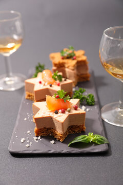 festive canape with foie gras and wine