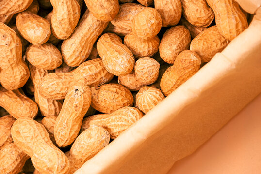Peanuts in a wooden container. Close up