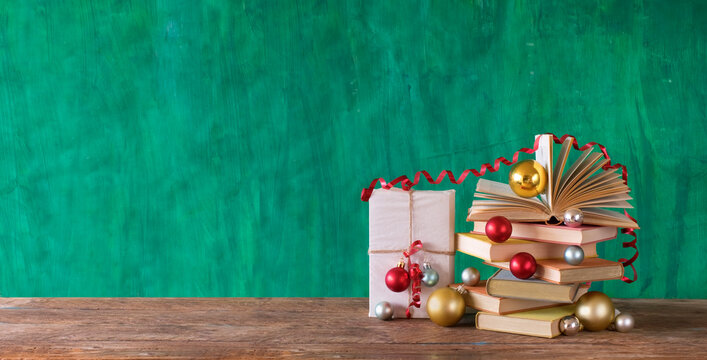 books as christmas gift,christmas present,reading,literature,education,making a gift concept