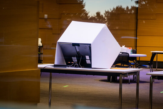 Voting machine sits in polling place before election day | voting security | election