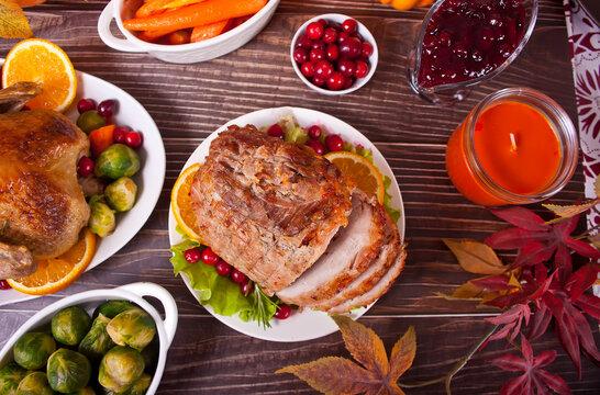 Traditional sliced honey glazed ham for festive Christmas or Thanksgiving table