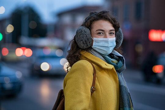Woman wearing face mask on city street