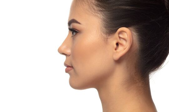 Profile. Portrait of beautiful young woman on white studio background. Concept of cosmetics, makeup, natural and eco treatment, skin care. Shiny and healthy look, fashion, healthcare. Copyspace.