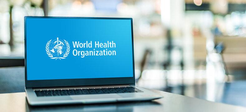 Laptop computer displaying logo of The World Health Organization