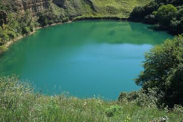 Panorama of alpine karst mountain lake Shadhurei