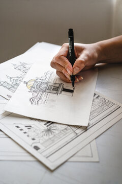 Hands drawing architecture and design