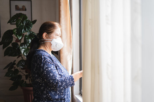 Woman in home during quarantine