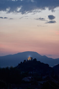 Landscape of a monastery on top of a mountain. Sunset light