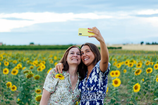 mother and daughter hugging taking a picture with the smartphone