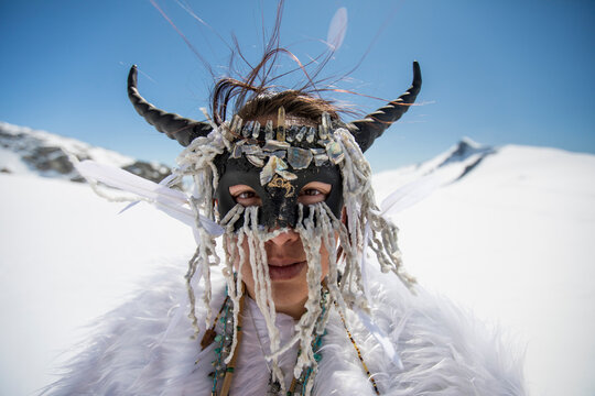 Aboriginal girl wearing face mask, dressed as mountain goat.