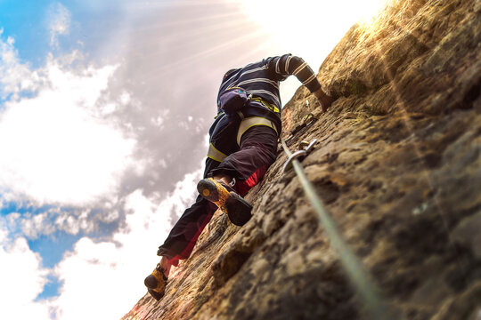 Climber with sun lights effects and a low point of view