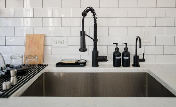 kitchen sink with white subway tiles