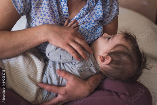 Infant contentedly gazing at mother while breastfeeding