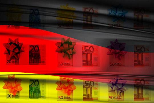Euro Bargeld mit Geschenkschleife und Flagge Deutschland