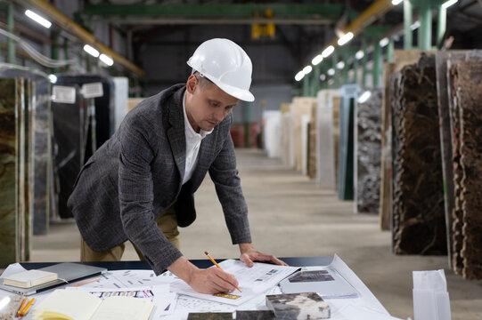 Focused architect creating new blueprint