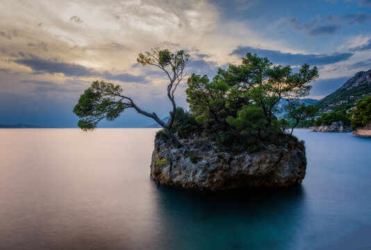 Brela Stone (Kamen Brela) - a symbol of Brela, a popular natural attraction in Croatia. Beautiful sunset view of Brela Stone, Punta Rata beach, Makarska riviera of Dalmatia, Croatia. Long exposure pic