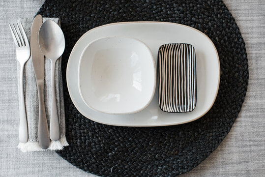 black and white dinner table place setting