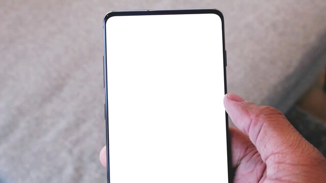 close up on hand holding modern mobile phone with blank empty white screen.