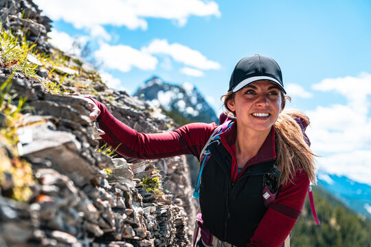 Hiker Balancing Herself Along Mountain Scramble in Kananaskis Country