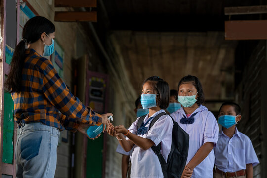 Teacher wearing protective mask to Protect Against Covid-19 and