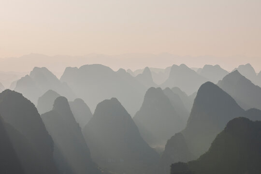 limstone mountains in the mist around Yangshuo in China