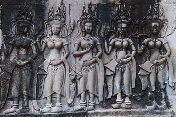 relief at the ancient temple ruins of Angkor Wat in Cambodia
