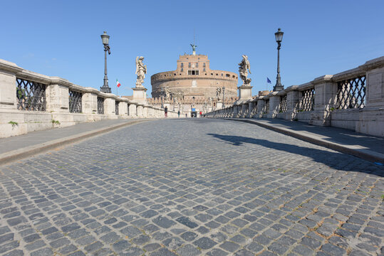 Rome, Italy - 12 March 2020:  the popular tourist spot of the Sant Angelo bridge is now deserted, a rare sight in Rome, Italy, after the Italian government decreed a nationwide lockdown