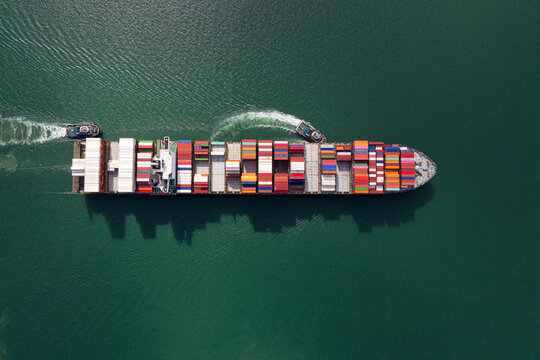 Container , container ship in export and import business and logistics. Shipping cargo to harbor by crane. Water transport International. Aerial view and top view.
