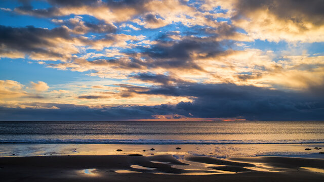 Sunrise and dawn sky over the North Sea off Brora beach in Sutherland in the Highlands