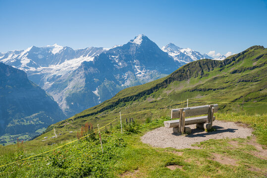 stunning view to swiss alps, lookout place with bench at Grindelwald First, bernese oberland
