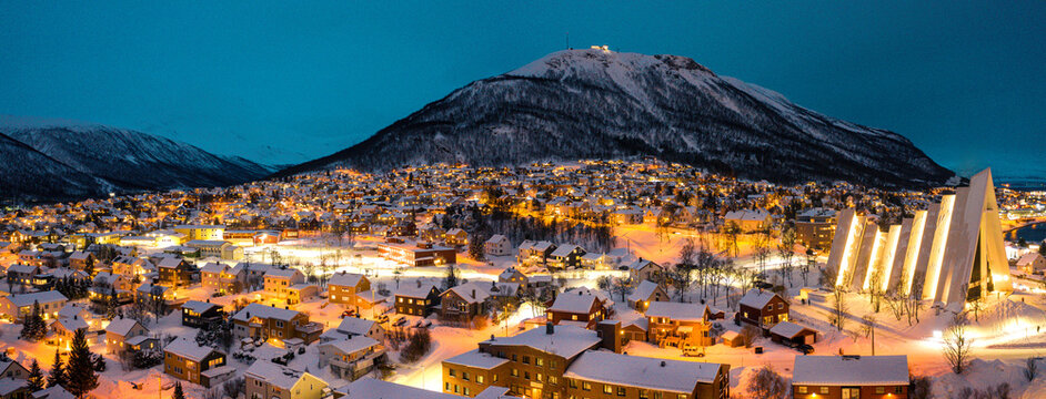 Tromso, Norway at night during the winter blue