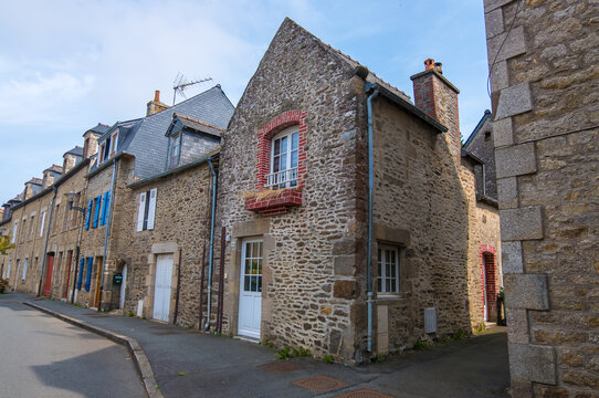 Dinan, France - August 26, 2019: Old street with stone medieval houses in the historic town centre of Dinan, French Brittany