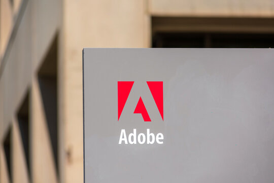 Close up. Adobe logo on signpost at Adobe Inc headquarters in the downtown of Silicon Valley largest city - San Jose, CA, USA - 2020