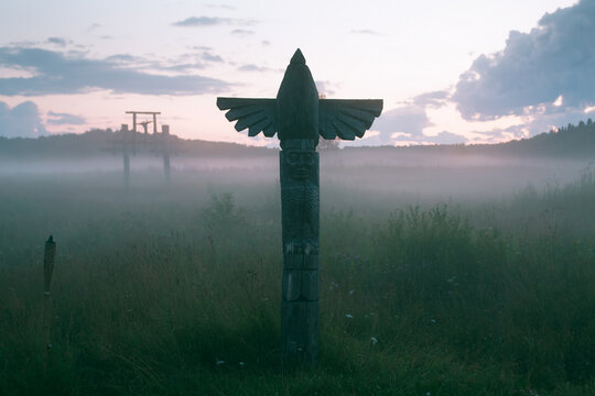 View of the field with an ancient totem at dusk, Northern Russia..
