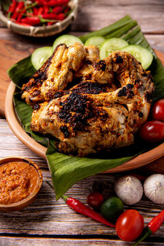 Ayam Taliwang or Ayam Betutu, famous Indonesia traditional food from Bali and Lombok. Grilled chicken with  local spices and herbs marinated