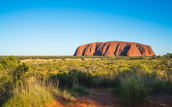 Scenic view of Uluru with clear blue sky on sunny summer day in NT outback Australia