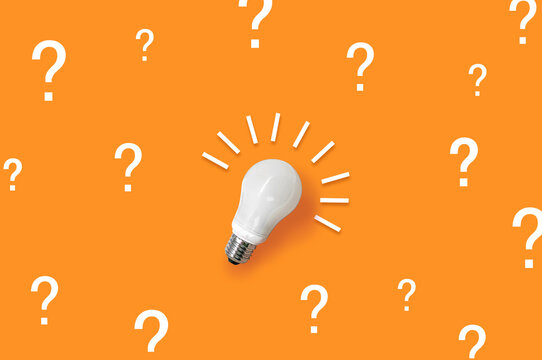 Question marks and a light bulb on isolated background