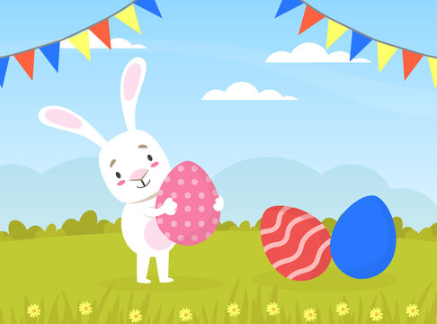 Cute White Rabbit with Colorful Easter Eggs on Standing on Green Lawn Cartoon Vector Illustration