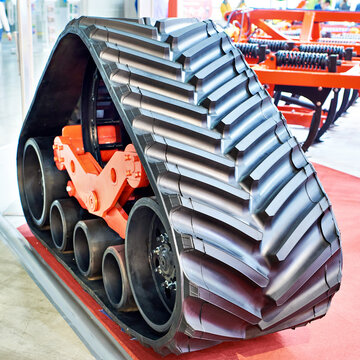 Replaceable continuous track drive for harvester