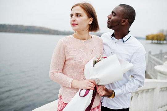 Happy multiethnic couple in love story. Relationships of african man and white european woman.