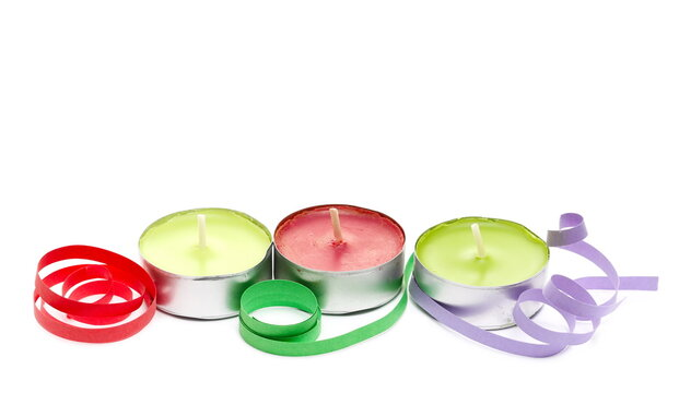 Colorful tea light candles and ribbons, curls isolated on white background, Christmas decoration